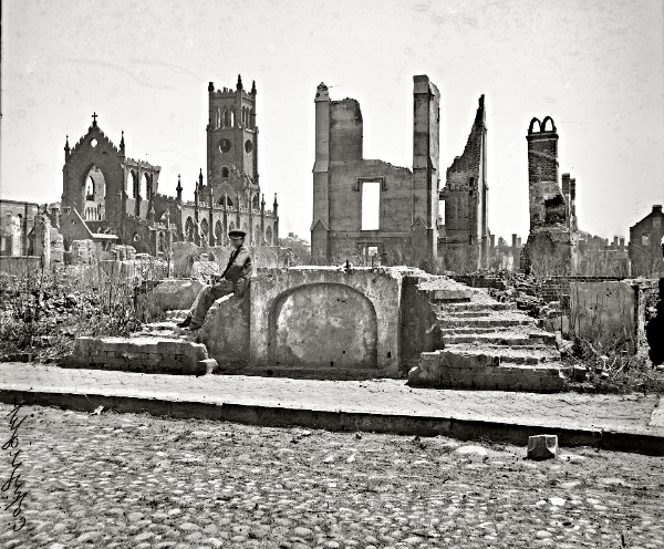 Ruins on Queen Street with the Cathedral of Saint John and Saint Finbar in the background on Broad Street. Photo by George N. Barnard, 1865. Library of Congress.