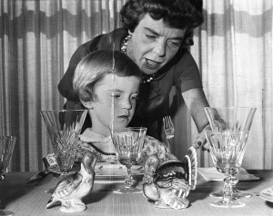 Photograph by George Brich, Valley Times Collection, Los Angeles Public Library. Photograph caption dated November 19, 1962 reads, 'Little Laurie, 4 1/2, learns everything about Thanksgiving from setting the table to its meaning.'