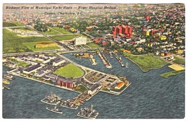 The Municipal Yacht Basin (center) is now Alberta Long Lake. The West Point Mill housed the US Atlantic Fleet Mine Force during the 1950s. Roper Hospital can be seen across Calhoun Street from the yacht basin, flanked by the Tuberculosis Sanitarium on the left and the medical school complex (large red group of buildings) on the right. Postcard from the 1950s retrieved at delcamp.net.