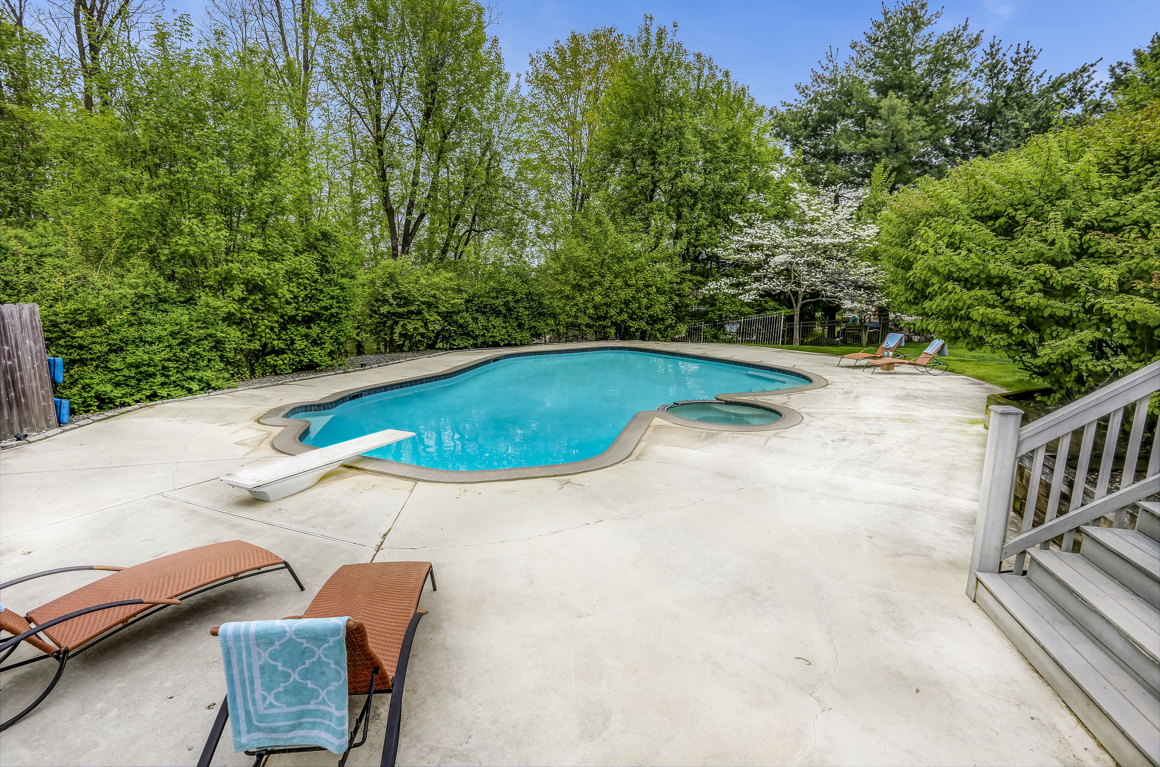 Backyard entertaining dream with heated pool, hot tub and huge deck!
